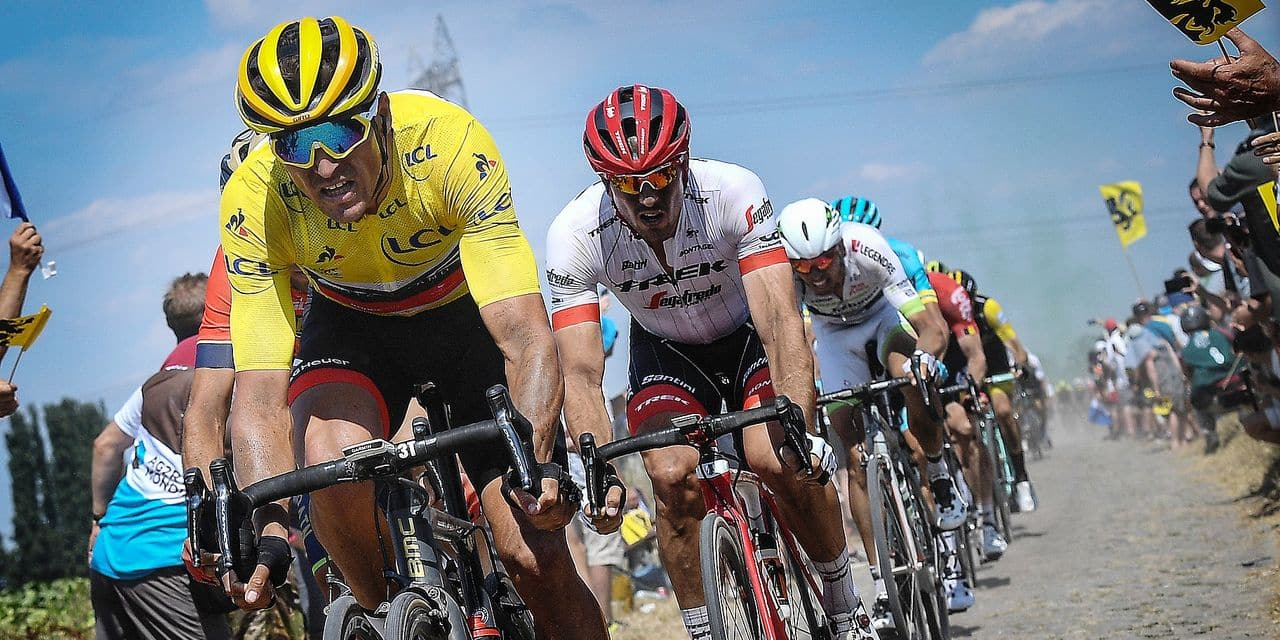Belgian Greg Van Avermaet of BMC Racing wearing the yellow jersey of overal leader and German John Degenkolb of Trek-Segafredo pictured in action during the ninth stage of the 105th edition of the Tour de France cycling race, from Arras Citadelle to Roubaix (156,5 km), in France, Sunday 15 July 2018. This year's Tour de France takes place from July 7th to July 29th. BELGA PHOTO DAVID STOCKMAN