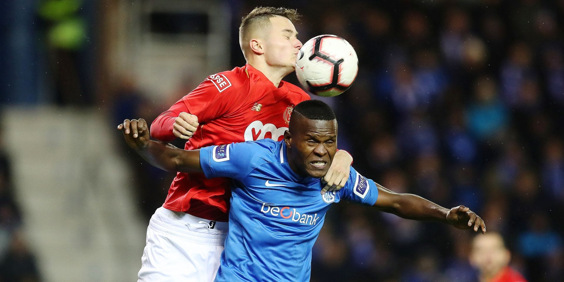 Standard's Zinho Vanheusden and Genk's Aly Mbwana Samatta fight for the ball during a soccer match between KRC Genk and Standard de Liege, Friday 08 February 2019 in Genk, on the 25th day of the 'Jupiler Pro League' Belgian soccer championship season 2018-2019. BELGA PHOTO BRUNO FAHY