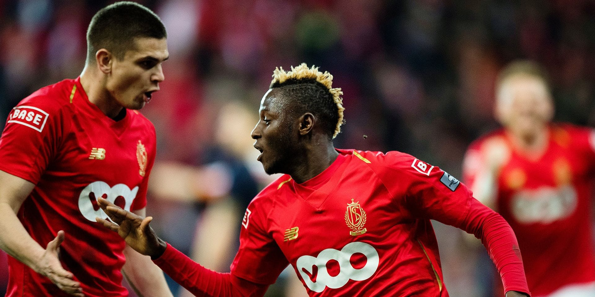 Standard's Razvan Marin and Standard's Moussa Djenepo celebrate after scoring during a soccer game between Standard de Liege and Royal Antwerp FC, Friday 29 March 2019 in Liege, on day 1 (out of 10) of the Play-off 1 of the 'Jupiler Pro League' Belgian soccer championship. BELGA PHOTO JASPER JACOBS