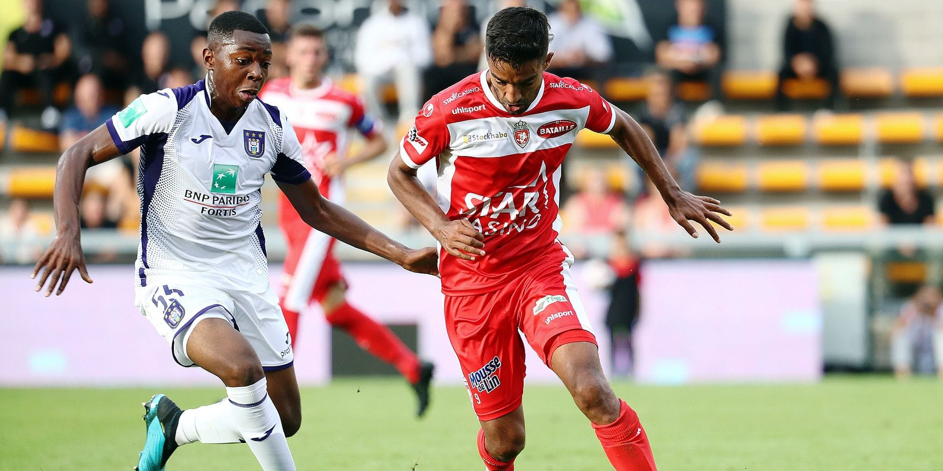 Anderlecht's Marco Kana and Mouscron's Sami Allagui fight for the ball during a soccer match between Royal Excel Mouscron and RSC Anderlecht, Sunday 04 August 2019 in Mouscron, on the second day of the 'Jupiler Pro League' Belgian soccer championship season 2019-2020. BELGA PHOTO VIRGINIE LEFOUR