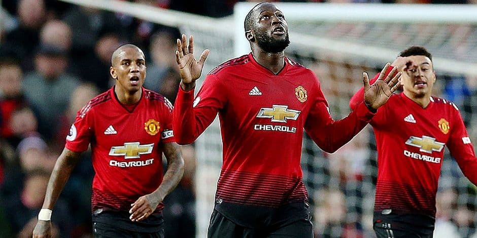 Manchester United's Romelu Lukaku, center, celebrates scoring his side's third goal of the game during their English Premier League soccer match against Fulham at Old Trafford, Manchester, England, Saturday, Dec. 8, 2018. (Barrington Coombs/PA via AP)
