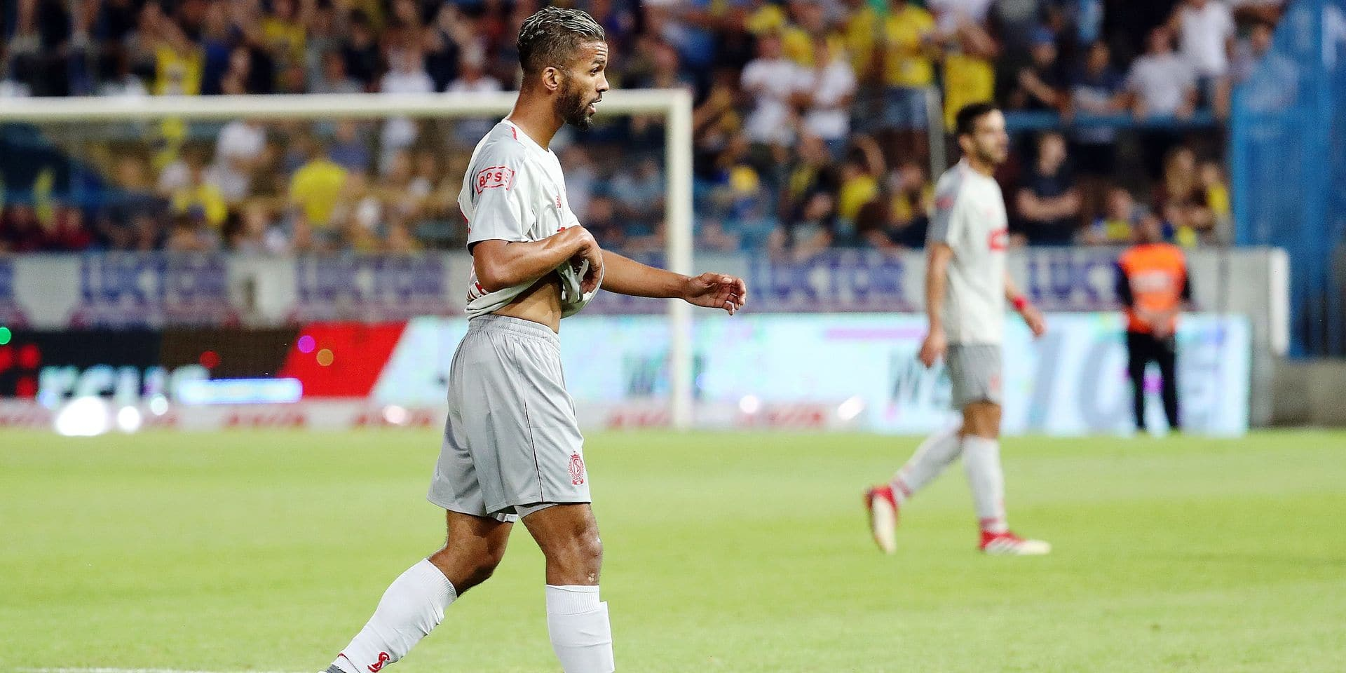 Standard's Mehdi Carcela leaves the field after receiving a red card during the Jupiler Pro League match between Waasland-Beveren and Standard de Liege, in Beveren-Waas, Friday 03 August 2018, on the second day of the Jupiler Pro League, the Belgian soccer championship season 2018-2019. BELGA PHOTO VIRGINIE LEFOUR