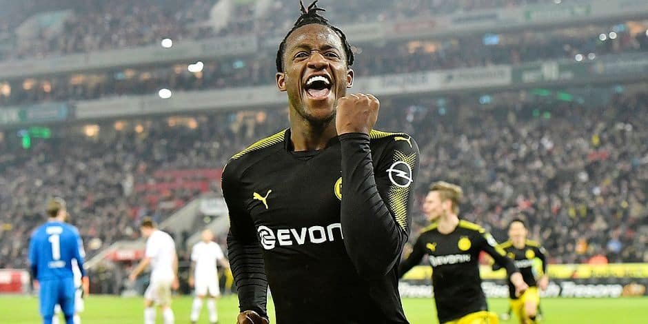 Dortmund's new forward Michy Batshuayi celebrates after scoring his second goal during the German Bundesliga soccer match between 1. FC Cologne and Borussia Dortmund in Cologne, Germany, Friday, Feb. 2, 2018. (AP Photo/Martin Meissner)