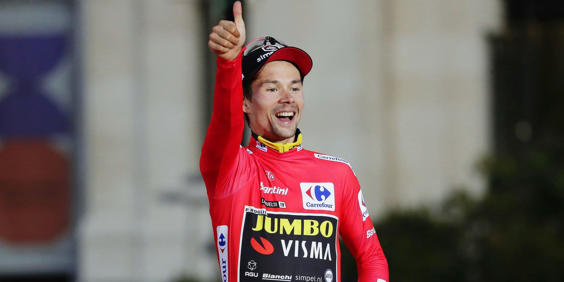 Primoz Roglic celebrates on the podium after winning La Vuelta cycling race in Madrid, Spain, Sunday, Sept. 15, 2019. (AP Photo/Manu Fernandez)